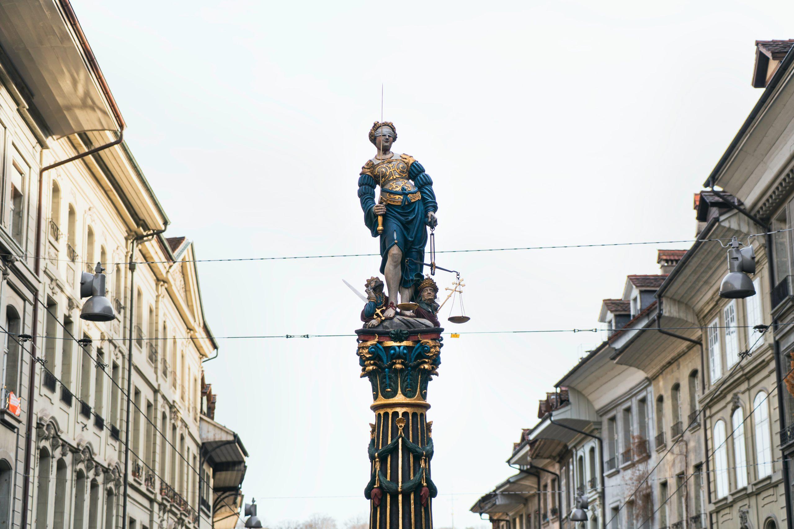 man in blue jacket statue